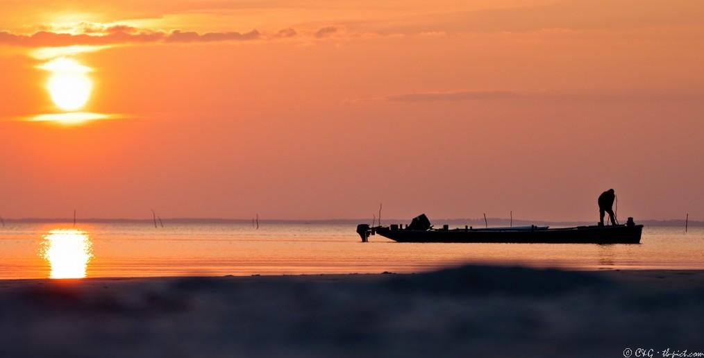 pecheur coucher de soleil